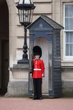 Queen's Guard. LONDON, UK - APRIL 23, 2016: Queen's Guard soldier stands in front of Buckingham Palace in London, UK. The guards in traditional uniforms are Royalty Free Stock Photography
