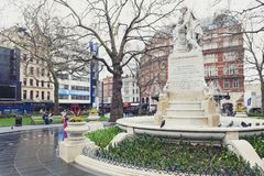 Marble statue of William Shakespeare at Leicester Square Garden in London, United Kingdom. London, UK - April 2018: The Shakespeare fountain and marble statue of stock image