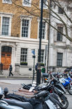 LONDON, UK - APRIL 9, 2013: Street with various bikes and motorcycles stock images