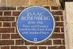 Isaac Rosenberg Plaque in London. LONDON, UK - APRIL 19TH 2018: A blue plaque marking the location where Poet and Painter Isaac Rosenberg once lived and studied stock photography