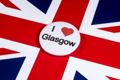 I Love Glasgow. LONDON, UK - APRIL 27TH 2018: An I Love Glasgow badge pictured over the UK flag, on 27th April 2018 Royalty Free Stock Photo