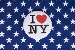 I Love New York. LONDON, UK - APRIL 27TH 2018: An I Love New York badge pictured over the USA flag, on 27th April 2018 stock image