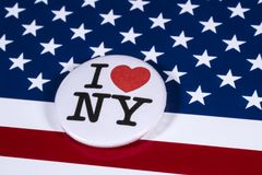 I Love New York. LONDON, UK - APRIL 27TH 2018: An I Love New York badge pictured over the USA flag, on 27th April 2018 royalty free stock photos