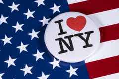 I Love New York. LONDON, UK - APRIL 27TH 2018: An I Love New York badge pictured over the USA flag, on 27th April 2018 royalty free stock image