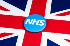 NHS Logo on the UK Flag. LONDON, UK - APRIL 27TH 2018: The National Health Service symbol over the UK flag, on 27th April 2018.  The NHS was established in 1948 Royalty Free Stock Photography