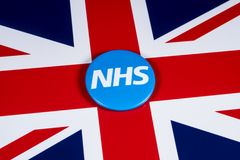 NHS Logo on the UK Flag. LONDON, UK - APRIL 27TH 2018: The National Health Service symbol over the UK flag, on 27th April 2018.  The NHS was established in 1948 Royalty Free Stock Photo