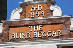 The Blind Beggar Pub in London. LONDON, UK - APRIL 19TH 2018: The original lettering on the exterior of The Blind Beggar public house on Whitechapel Road in Stock Photography