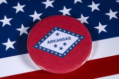 State of Arkansas in the USA. LONDON, UK - APRIL 27TH 2018: The symbol of the State of Arkansas, pictured over the flag of the United States of America, on 27th Royalty Free Stock Images