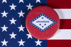 State of Arkansas in the USA. LONDON, UK - APRIL 27TH 2018: The symbol of the State of Arkansas, pictured over the flag of the United States of America, on 27th Royalty Free Stock Photography
