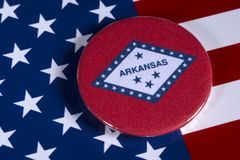 State of Arkansas in the USA. LONDON, UK - APRIL 27TH 2018: The symbol of the State of Arkansas, pictured over the flag of the United States of America, on 27th Royalty Free Stock Photo