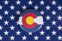 State of Colorado in the USA. LONDON, UK - APRIL 27TH 2018: The symbol of the State of Colorado, pictured over the flag of the United States of America, on 27th royalty free stock images