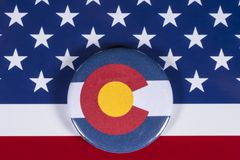 State of Colorado in the USA. LONDON, UK - APRIL 27TH 2018: The symbol of the State of Colorado, pictured over the flag of the United States of America, on 27th royalty free stock photography