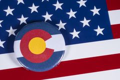 State of Colorado in the USA. LONDON, UK - APRIL 27TH 2018: The symbol of the State of Colorado, pictured over the flag of the United States of America, on 27th stock images