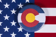 State of Colorado in the USA. LONDON, UK - APRIL 27TH 2018: The symbol of the State of Colorado, pictured over the flag of the United States of America, on 27th stock image