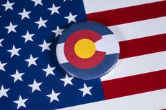 State of Colorado in the USA. LONDON, UK - APRIL 27TH 2018: The symbol of the State of Colorado, pictured over the flag of the United States of America, on 27th stock photos