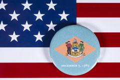 State of Delware in the USA. LONDON, UK - APRIL 27TH 2018: The symbol of the State of Delaware, pictured over the flag of the United States of America, on 27th Stock Images