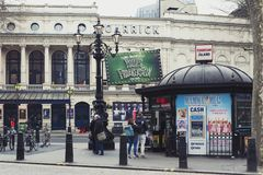 Ticket office and tourist information booth of Tourism Island on Charing Cross Road with Garrick Theatre visible in background. London, UK - April 2018: Ticket royalty free stock image
