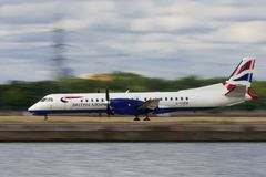 Saab 2000 airplane take off from London City Airport Royalty Free Stock Photography