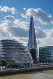LONDON, UK - AUGUST 22 : City Hall and the Shard in London on Au. Gust 22, 2014. Unidentified people Stock Images