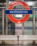 Westminster tube station roundel. LONDON, UK - 29 AUGUST 2017: London Underground roundel at Westminster tube station on the Jubilee Line Royalty Free Stock Image