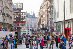 Lots of people, tourists, Londoners shoppers at the Leicester square. Populated city concept. London, UK. London, UK - August 24, 2016: Lots of people, tourists Stock Photo