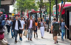 Lots of people walking in Oxford street, the main destination of Londoners for shopping. Modern life concept. London. London, UK - August 24, 2016: Lots of royalty free stock photo