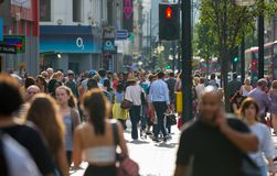 Lots of people walking in Oxford street, the main destination of Londoners for shopping. Modern life concept. London. London, UK - August 24, 2016: Lots of stock image