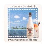 LONDON, UK - AUGUST 22, 2018: Malibu rum vintage mat coaster isolated on white background. LONDON, UK - AUGUST 22, 2018: Malibu rum vintage paper mat coaster Stock Images