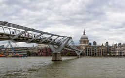 London, UK - August 8, 2016: The Millennium bridge and St Pauls cathedral Royalty Free Stock Images
