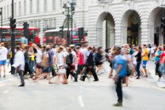 Piccadilly circus with lots of people, tourists and Londoners crossing the junction. London, UK Royalty Free Stock Photos