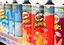 LONDON, UK - AUGUST 31, 2018: Pringles potato chips crisps containers on the shelf in food store. Close up royalty free stock photos