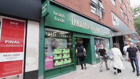 London / UK - August 6th 2019 - Holland & Barrett shop front on High Holborn.  stock video footage