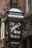 The Jamaica Wine House in London. LONDON, UK - AUGUST 25TH 2017: The traditional sign to the Jamaica Wine House located in St. Michaels Alley in the City of Stock Image