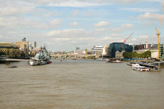 London, UK - 31 August 2016: View of HMS Belfast ship on river Thames with Tower of London Bridge in the background. Royalty Free Stock Images