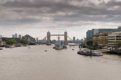 London, UK - 31 August 2016: View of HMS Belfast ship on river Thames with Tower of London Bridge in the background Stock Image
