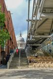 London, Uk - August 3, 2017: View of St. Paul& x27;s Cathedral from the riverside underneath the Millennium. Bridge. Daytime shot with jogger running down the royalty free stock photos
