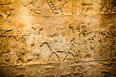 LONDON, UK, BRITISH MUSEUM - Details from the Assyrian wall Stock Image