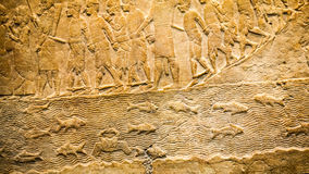 LONDON, UK, BRITISH MUSEUM - Details from the Assyrian wall Royalty Free Stock Images