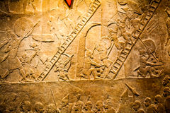 LONDON, UK, BRITISH MUSEUM - Details from the Assyrian wall Royalty Free Stock Photography