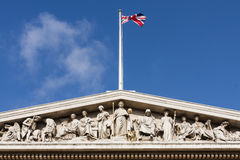 London, UK, British Museum Facade and Union Jack Royalty Free Stock Photos