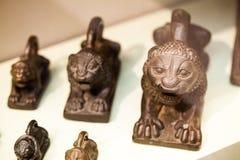 LONDON UK, BRITISH MUSEUM kungligt lejon formade vikter - nordliga Irak Royaltyfri Bild