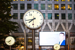 LONDON, UK Canary Wharf business square with clocks Royalty Free Stock Photos