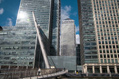 LONDON, UK - CANARY WHARF, MARCH 22, 2014. Modern glass buildings of biggest business district in London, View on Canada tower from the bridge Royalty Free Stock Image