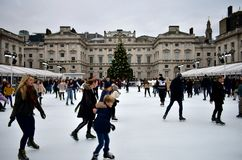 People skating on ice at the Somerset House Christmas Ice Rink. London, United Kingdom, December 2018. royalty free stock image