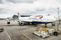 British Airways aircraft. LONDON, UK - CIRCA 2017: British Airways Boeing 747 airliner parks at a gate at Heathrow Airport Terminal 5 stock photography