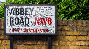 Abbey Road sign in London (hdr). LONDON, UK - CIRCA JUNE 2017: Abbey Road street sign made famous by the 1969 Beatles album cover (high dynamic range stock photo