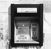 Automated Teller Machine (ATM) in London black and white. LONDON, UK - CIRCA JUNE 2017: Barclays bank invented Automated Teller Machine (ATM) in 1967. It is now Royalty Free Stock Image