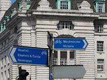 Direction signs in London. LONDON, UK - CIRCA JUNE 2018: Bike lane direction signs for Vauxhall, Elephant and Castle, Kennington, Westminster and Victoria stock image
