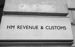 HMRC in London black and white. LONDON, UK - CIRCA JUNE 2017: HMRC Her Majesty Revenue and Customs sign in black and white Royalty Free Stock Photos