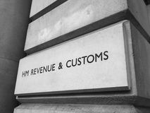 HMRC in London black and white. LONDON, UK - CIRCA JUNE 2017: HMRC Her Majesty Revenue and Customs sign in black and white Stock Image